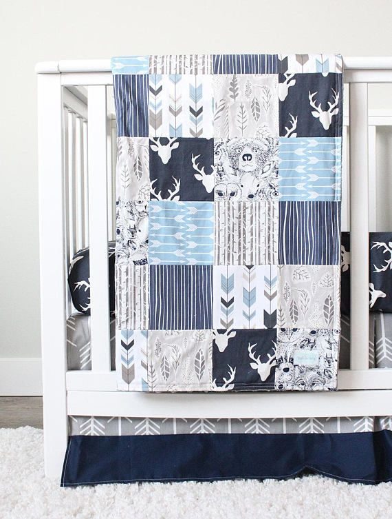 Boy Crib Bedding - Navy Arrow and Woodlands Crib Bedding **** Crib Skirt - 14 drop, center pleat - Sold navy Crib Sheet - navy buck head Patchwork Blanket - 34 x 49, backed with gray minky - birch trees, navy woodgrain, navy woodlands animals, blue/taupe fletching arrow, navy buck head, grey leaf, slate blue arrow. Add batting to blanket - https://www.etsy.com/listing/85090201/batting-add-to-blanket?ref=shop_home_active_3 Bumper - solid grey with navy p...