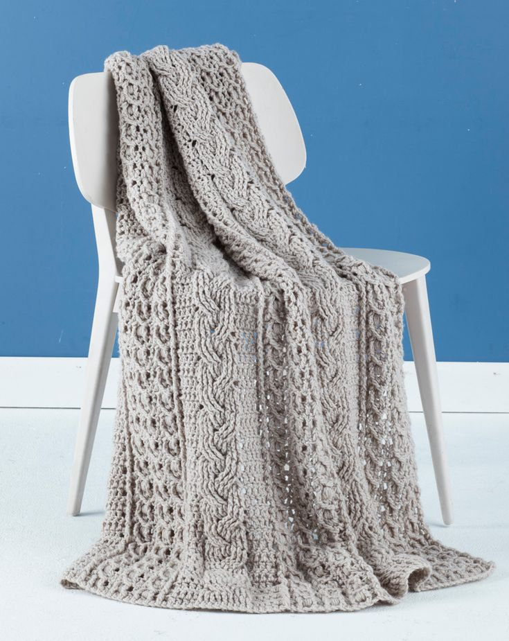 Make this knit-look crochet cabled throw with Lion Brand Vanna's Choice for a beautiful and timeless addition to your decor! This also makes a fabulous gift!