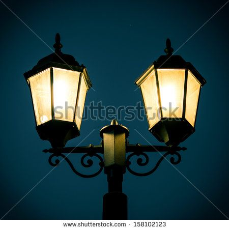 Street lamp post at night time. - stock photo