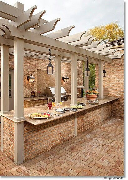 Wow so much in a picture; ledger stone, brick paver deck, pergola, outdoor custom kitchen, granite counter top...
