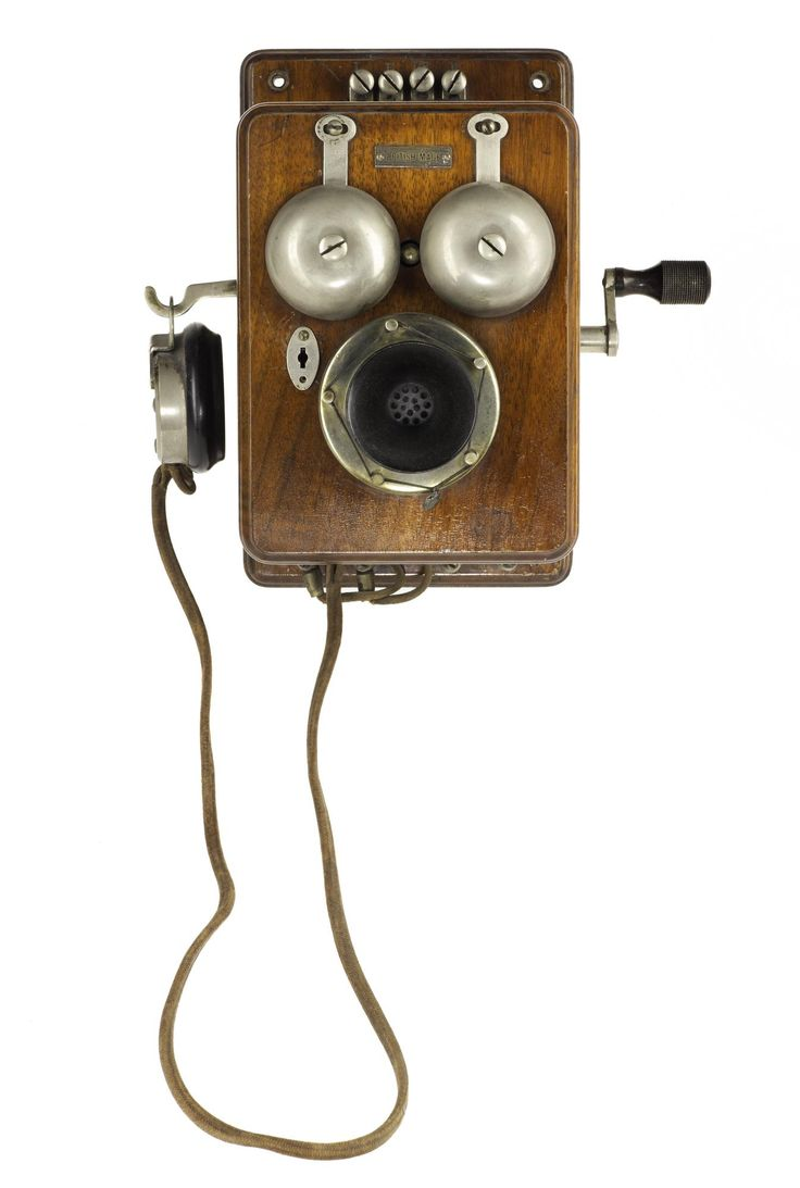 Telephone wall mounting, with a hand-generator, made by Sterling of London, 1905 - 1910.