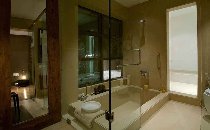 elegant stylish interior with wooden material and lamp design beautiful modern bathroom glass shower door residential apt in mumbai