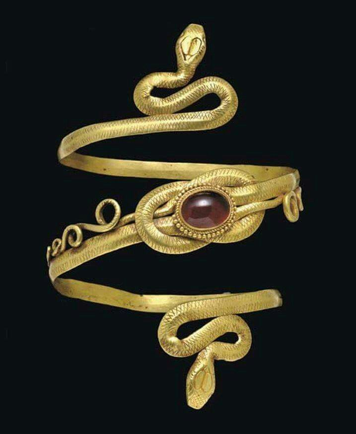 A golden Hellenistic snake arm band with garnet inlay and featuring the Reef Knot (aka Hercules Knot); circa 3rd - 2nd century BC, Pforzheim Museum, Baden-Württemberg, Germany