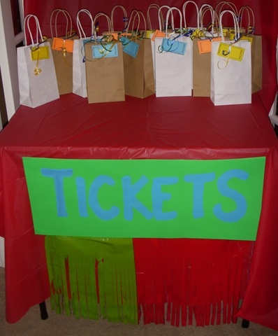 Ticket booth and treat bags for carnival party
