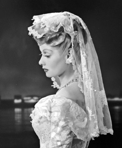 Lucille Ball married Desi Arnaz on November 30, 1940. A most beautiful bride…such a serious look for a funny lady.)