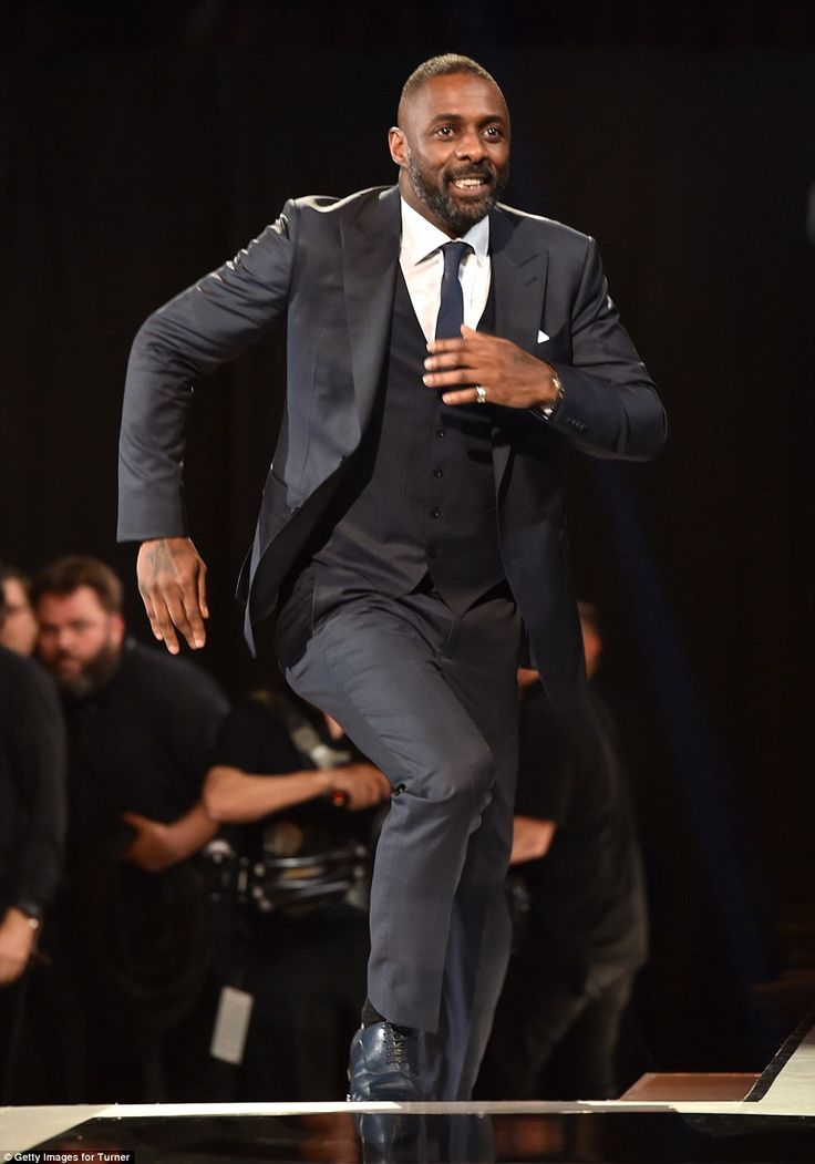 Spring in his step: Elba literally bounded up the steps onto the stage and couldn't contai...