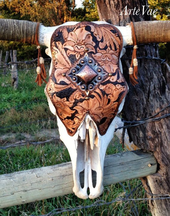 Western with a touch of modern glam. Steer skulls are a do.