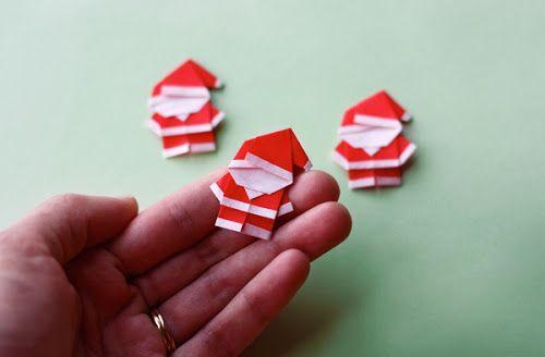 Fold tiny origami Santas
