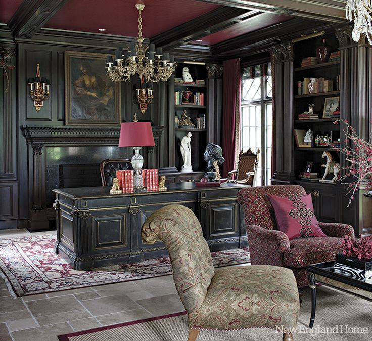 Dramatic and cozy library in shades of gray and burgundy.