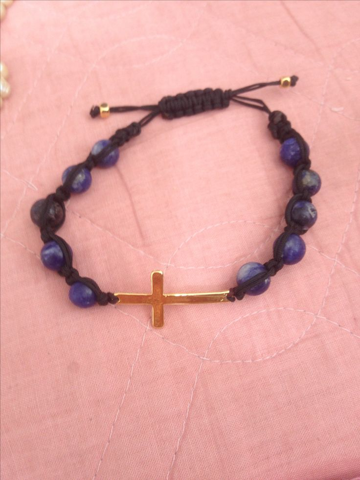 Golden cross, blue & black friendship bracelet.