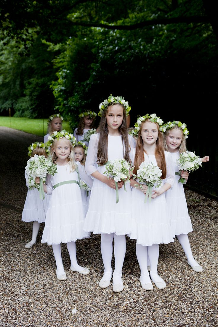 """""""The bridesmaids were our nieces, goddaughters, and the children of best friends and they carried posies packed with sweet peas from our own garden and had ivy and roses in their hair."""""""