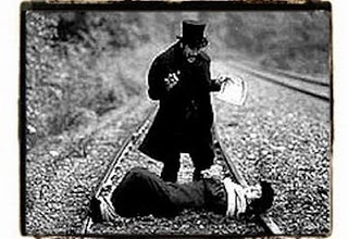 Tied to train track,,was in alot of old movies with villan