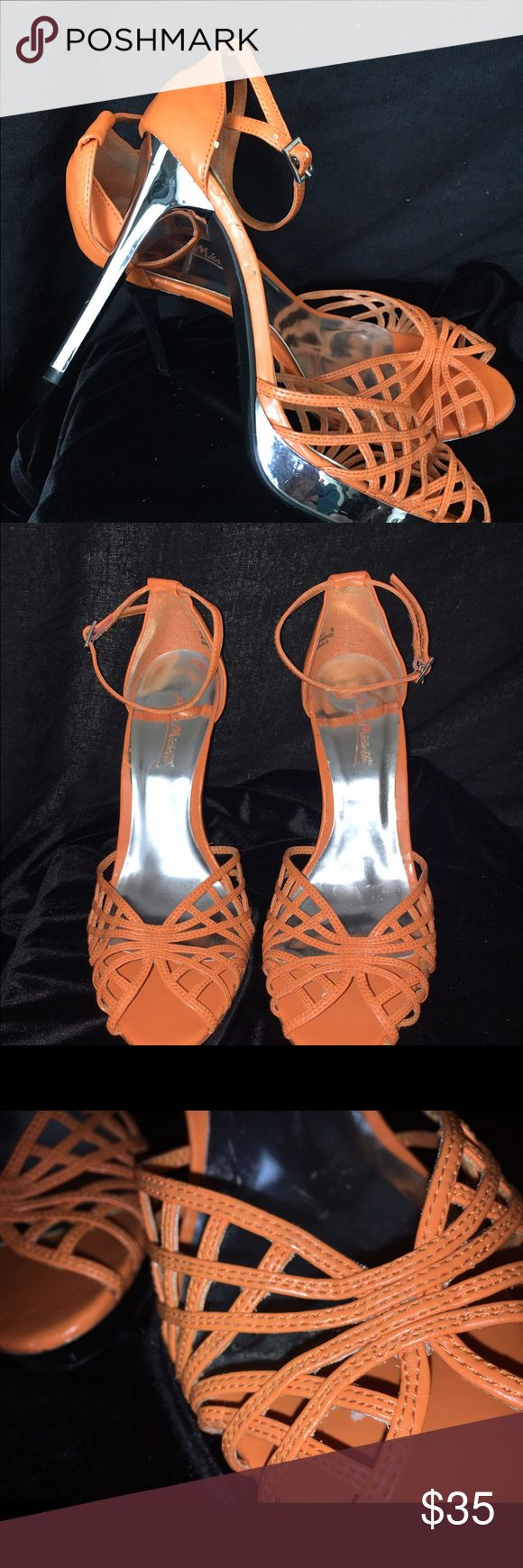 Ladies shoes Orange with chrome silver heels nice!  Small unnoticeable nick inside sole tiny scratch on heel. These two things are  very unnoticeable doesn't really show up in pictures. Shoes Heels