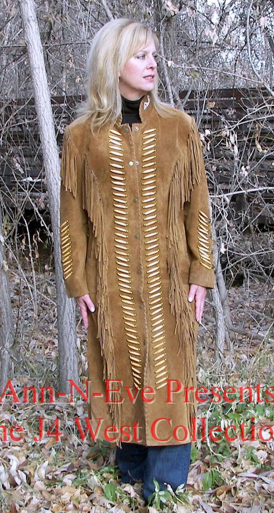 This beautiful duster coat is embellished with bone beads and fringes.  It has the look of a Southwestern Duster Coat.  The soft Suede with all its details on the sleeve and the stand up collar makes this a unique coat to wear for any Formal Western Wear or just for a casual look.  Where ever you wear this duster coat you will turn heads.  The length is to the ankel.  100% Genuine Suede.  Dry Clean