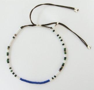 Camoflage friendship bracelet: White camoflage friendship bracelet on 100% silk thread.  Size adjustable.  $30