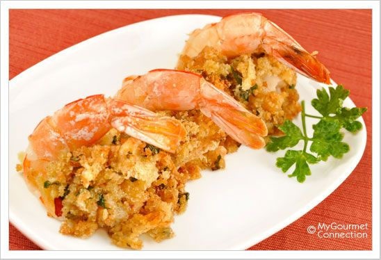 Stuffed Shrimp Oreganata ◦1 pound jumbo or colossal shrimp (less than 12 per pound) ◦4 tablespoons butter, melted ◦2 tablespoons olive oil ◦2 teaspoons garlic, minced ◦1/4 cup dry white wine ◦2 cups of fresh breadcrumbs ◦2 tablespoons freshly grated parmesan cheese ◦1-1/2 tablespoons parsley, chopped ◦1 teaspoon dried oregano ◦1/2 teaspoon crushed red pepper ◦1/2 teaspoon salt ◦1/2 teaspoon freshly ground black pepper ◦1 tablespoon lemon juice