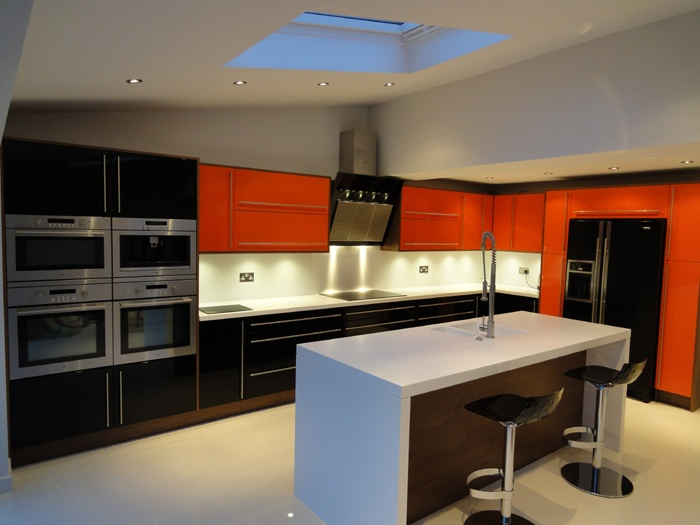 High Gloss Lacquered Orange Kitchen with Real Wood Veneer. www.kbstoretrade.co.uk