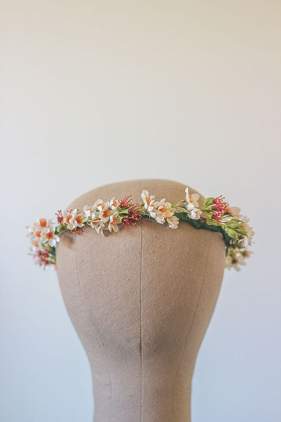 This wild and rustic Australian native crown is made from cream and red wax flowers and leaves and complimented with some re-purposed leather cord. Wear it with a cream lace dress and some lippy to achieve understated elegance, or for your next special occasion photo shoot. Last photo by Bellos Photography (www.facebook.com/BellosPhotography.com.au) The circumference of the canvas model head is 52cm. All flower crowns with looped ends are very versatile and can have ribbons or cords c...