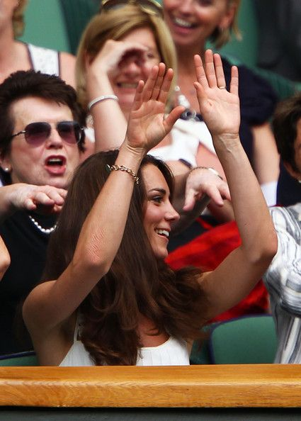 Catherine, Duchess of Cambridge participates in the wave during the fourth round match between Rafael Nadal of Spain and Juan Martin Del Potro of Argentina on Day Seven of the Wimbledon Lawn Tennis Championships at the All England Lawn Tennis and Croquet Club on June 27, 2011 in London, England.