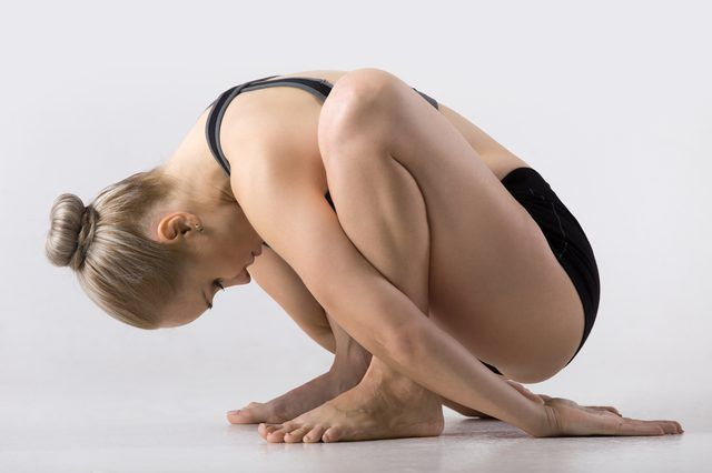 A full expression of Malasana has you bound in a deep squat.