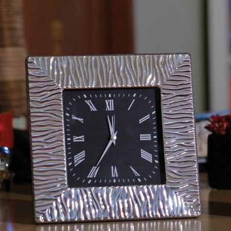 Ornate Sterling Silver Clock: Luxurious clock with an etched sterling silver frame for a stylish desk accessory.