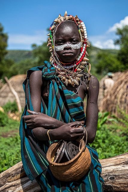 little boy with his face painted and shell necklace around the neck of the Mursi tribe, Lower Omo Valley-Ethiopia. | Flickr - Photo Sharing!