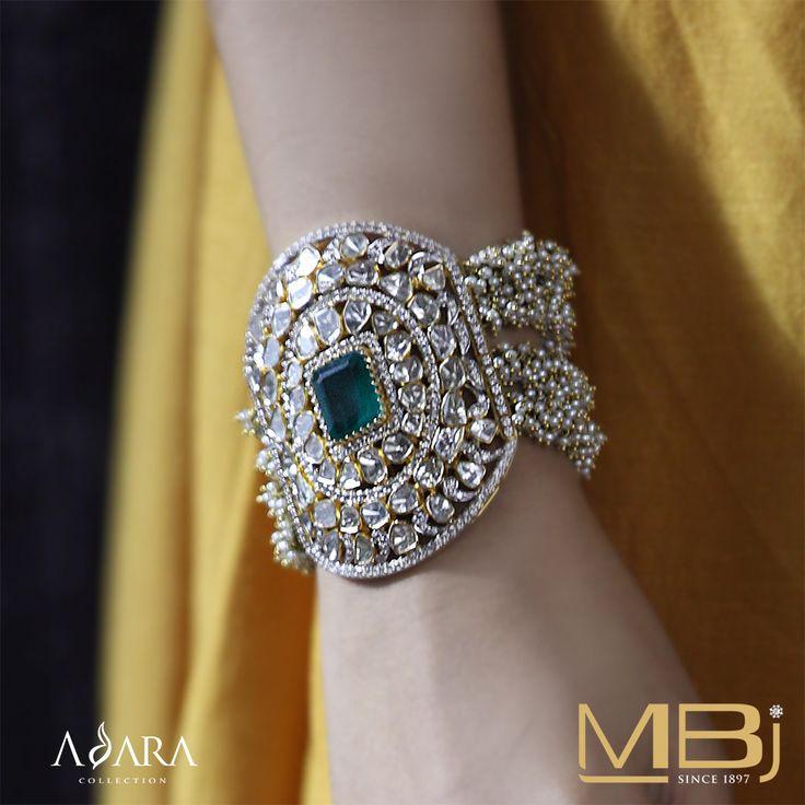Diamond polki bracelet with emerald and pearls.