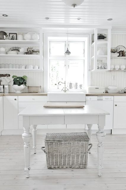 Lovely All White Kitchen . Love this table for island !