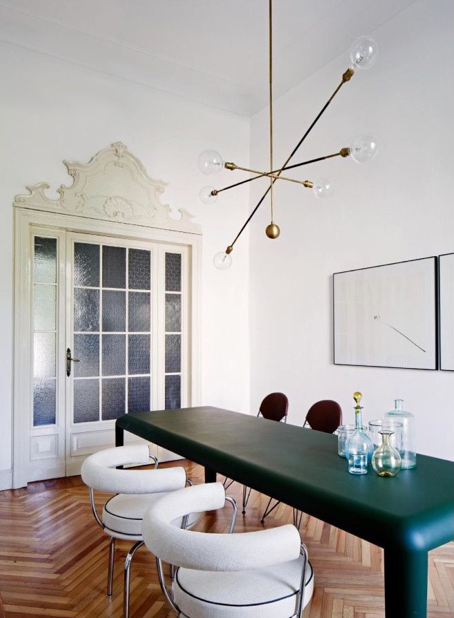 Sputnik chandelier and vintage furniture look amazing in a pared back scheme with period features
