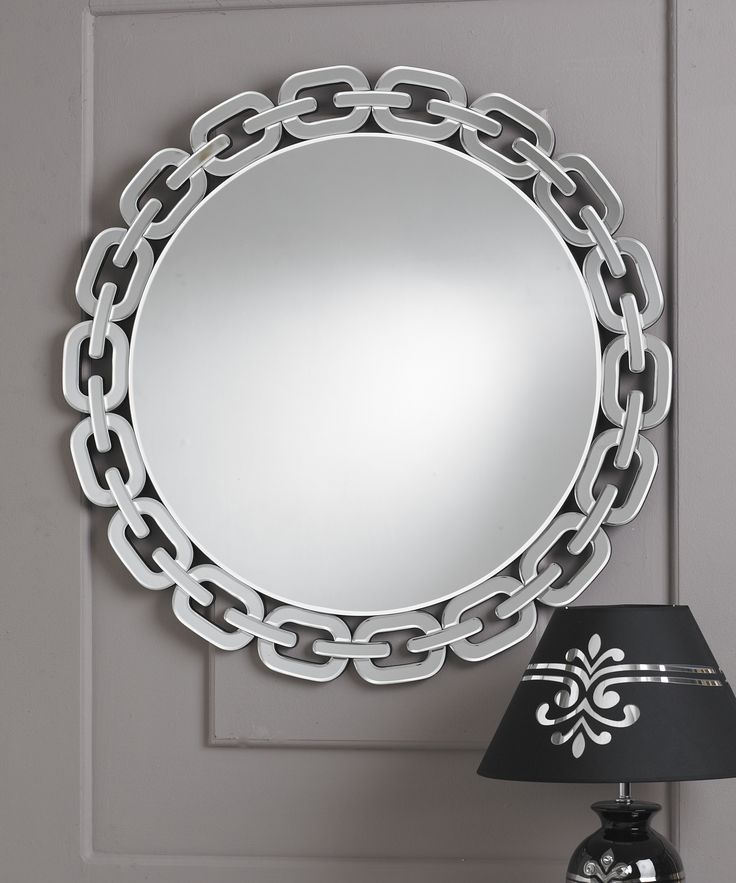 This is a remarkable circular designer mirror which has an unusual border made to look like a series of chain links