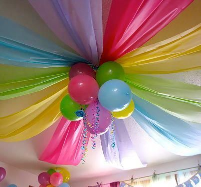 Cute decoration idea with plastic table clothes and balloons.