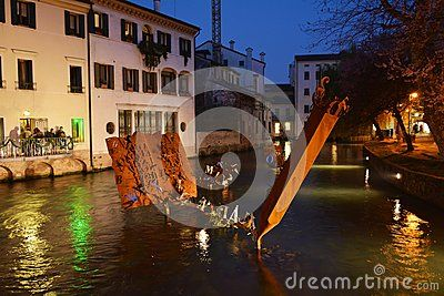 River by night and historical buildings in Treviso, north Italy, Europe.