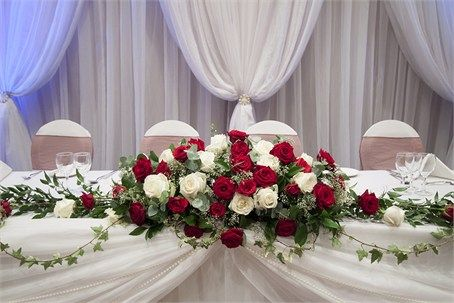 Red and Ivory Rose Top Table Spray Arrangement with Trailing Ivy and Pearls from Picture Perfect Events UK