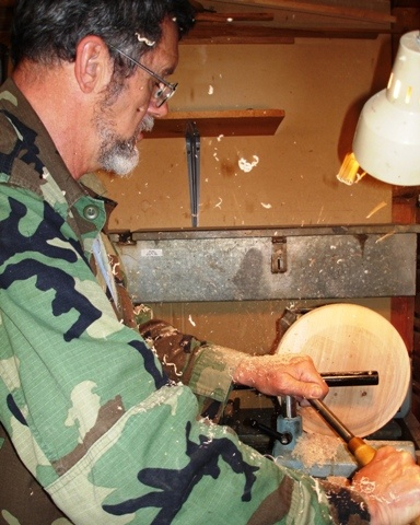 My guy, working on his wood art.