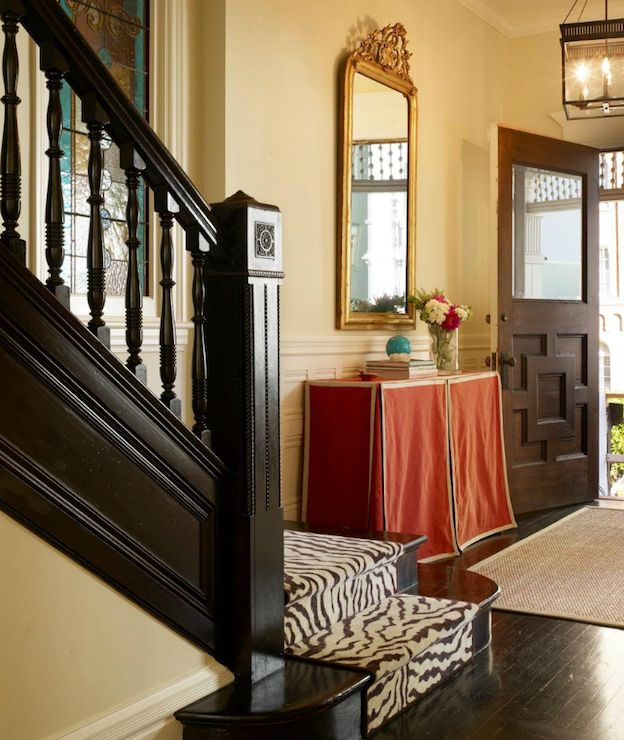 Michael Venera Photography: Chic foyer with zebra staircase runner, glossy black staircase, sisal rug, red skirted ...