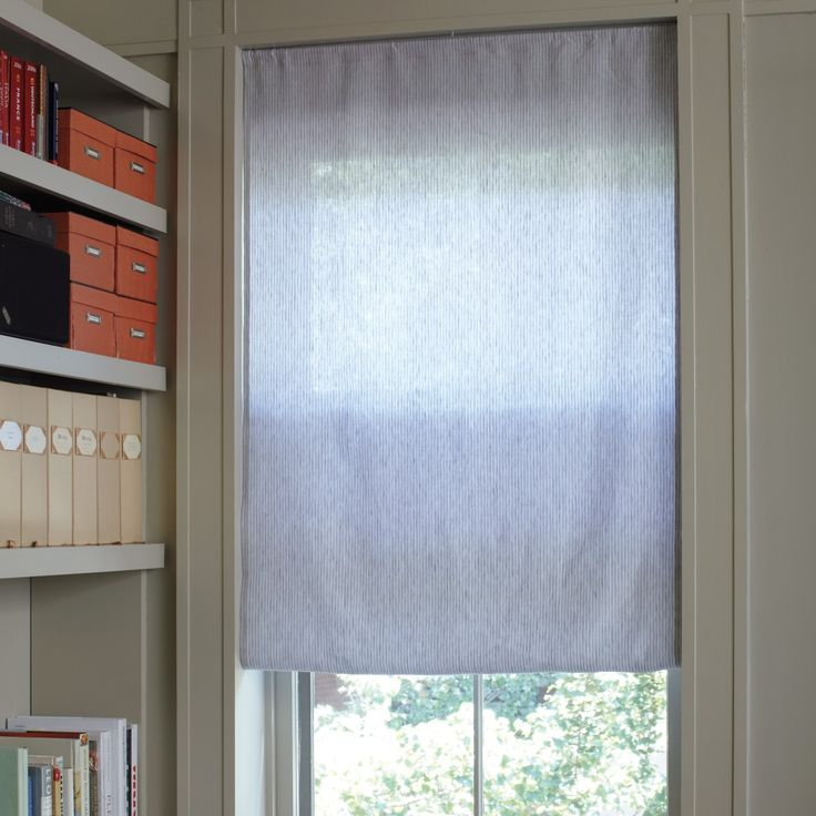 Try this quick and inexpensive way to get the look of a Roman shade.