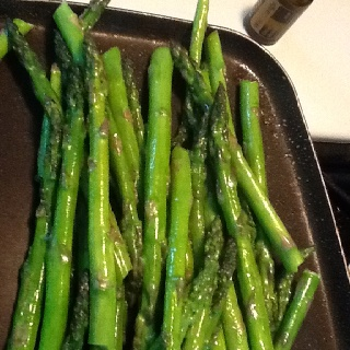 Orange scented asparagus.   Pour a tsp of olive oil in sauté pan. Add 3-4 drops of Wild Orange essential oil. Swirl pan to mix oils while heating. Place washed and trimmed pencil asparagus in the pan. Sprinkle with a good salt. Sauté till tender.