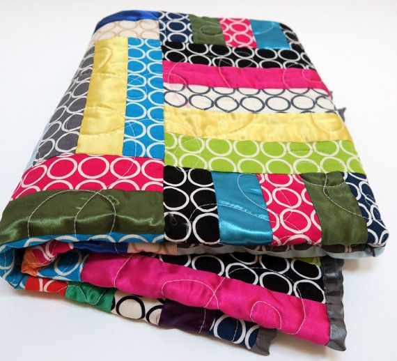 Designer mid-century modern baby quilt with mod circles and satins.