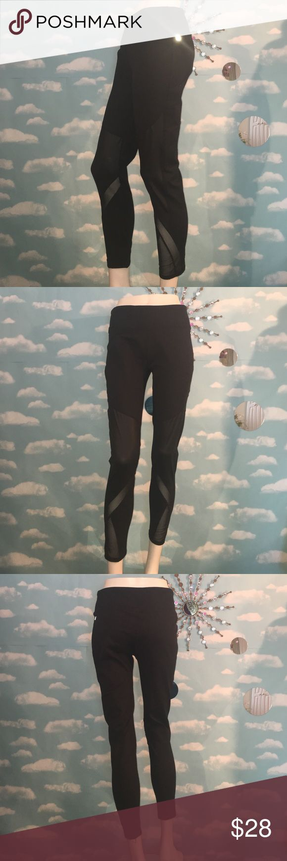 """Fabletics Crops New! Tags have been removed, beautiful black Fabletics Crops with mesh design on lower leg, also has a black, shiny patch of fabric on each leg that looks like leather! Size large, tight fit, inseam is approximately 26"""".  🚫No Trading please, Posh rules only, reasonable offers welcome! Thanks for looking! Fabletics Pants"""