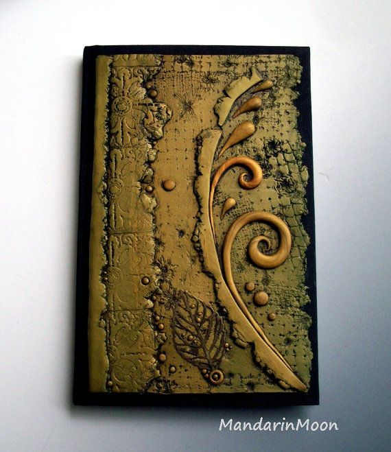 I decorated this unique journal/sketchbook with a polymer clay piece of my own design. It is a beautiful blend of olive green and gold clay. All of
