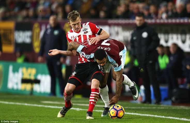 Andre Gray takes a tumble under challenge from Southampton's James Ward-Prowse during the second half