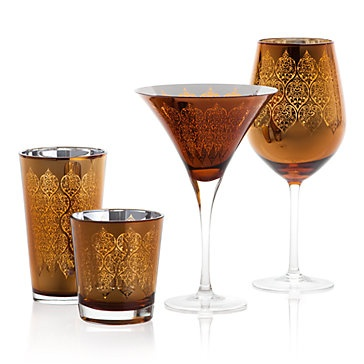 Intricately etched metallic glassware in amber gold cleverly paired with a silver interior. Puccini Glassware, $31.80