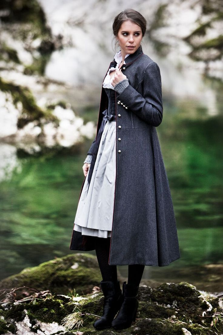 Love the long dark coat in combination with the dirndl