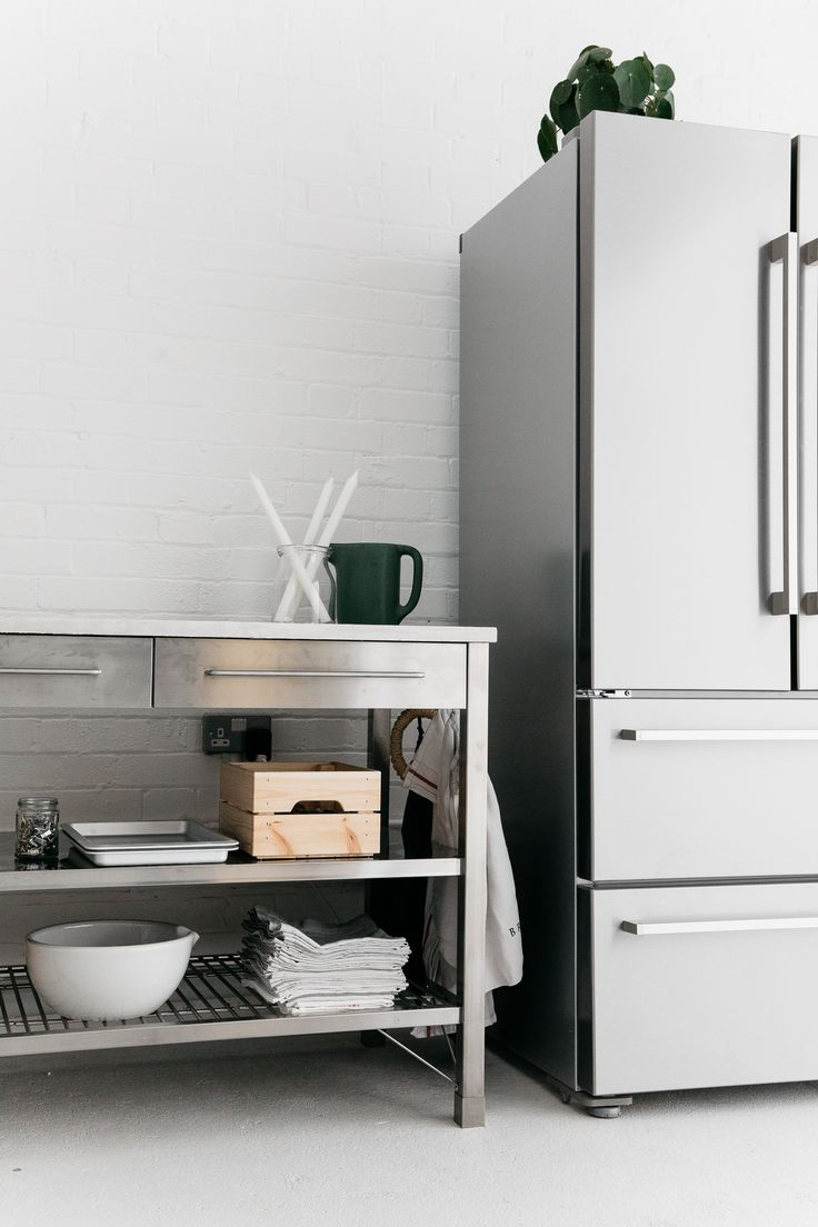 Rye London kitchen stainless steel Smeg refrigerator and stainless Ikea hack kitchen work table