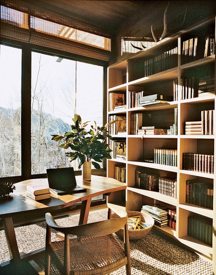 Floor to ceiling bookcases AND windows.    aerin lauder aspen vogue