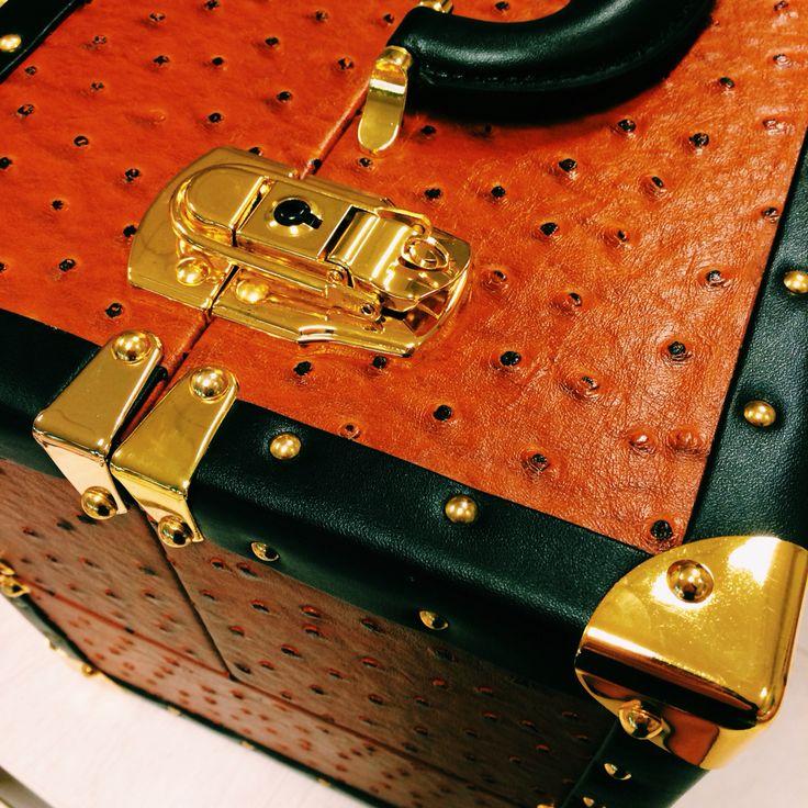 Golden-studded vintage style makeup case