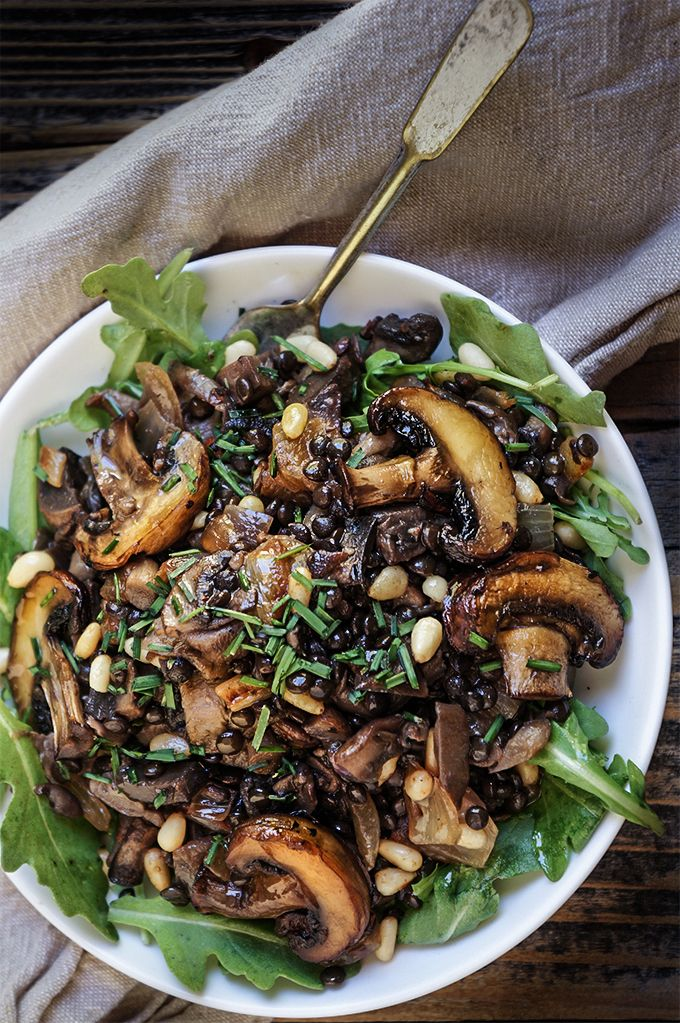 Sauteed oyster and brown mushrooms, black lentils, and caramelized onions  are the basis for this lovely fall salad, with pine nuts and capers adding a great flavor boost. | www.viktoriastable.com
