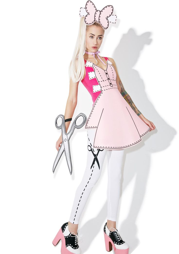 Pretty Paper Doll Costume cuz yer playin' da ultimate game of dress up. Come to lyfe in this playful doll costume with its bright pink supa snug fitting sleeveless bodysuit and white leggings with cute cut on the dotted line details. Featurin' a fab foam dress to give the illusion that it was cut out especially for yew with a fun foam scissor bracelet and oversized hair bow.