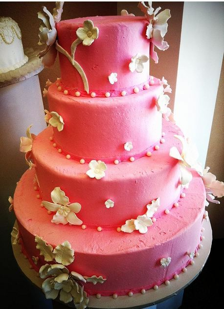 Four tier pink round wedding cake with white flowers.JPG
