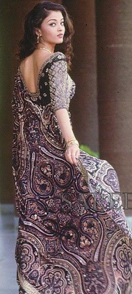 Bollywood actress Aishwarya Rai in beautiful black designer saree with printed and embroidered border work paired with designer embroidered quarter sleeves saree